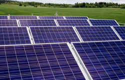 Surface of the a solar panel on field Royalty Free Stock Images