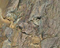 Surface of stone with crumpled craft paper texture and two coins Stock Photo