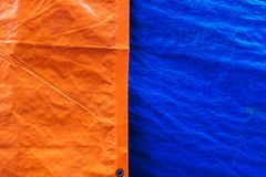 Orange and blue tarpaulins fabric texture background. Surface of tarpaulins fabric material, orange and blue color, with the texture zoom out looking Royalty Free Stock Photos