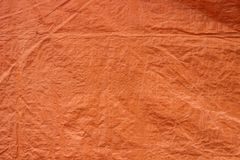 Orange tarpaulins fabric texture background. Surface of tarpaulins fabric material, orange color, with the texture zoom out looking Royalty Free Stock Images