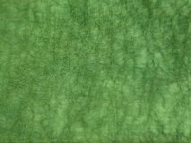 Texture of green color and crumpled canvas fabric stock image