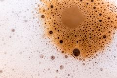 Surface texture of hot milk coffee and soft froth. Close up food background stock images
