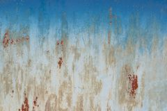 The surface texture of the old metal with a slight residue of paint,. Abstract grunge retro background Stock Photo
