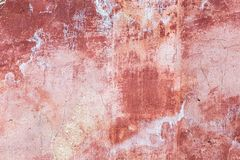 Old weathered red exterior wall. Surface texture of an old weathered red exterior wall background stock image
