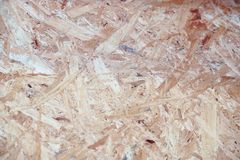 Surface texture of OSB Oriented strand board. Background stock photo