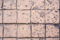 Surface texture of outdoor heavy tiles flooring. Surface texture of outdoor heavy square tiles flooring Royalty Free Stock Photography