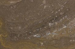 Surface of the travertine. Reddish-brown. Royalty Free Stock Images