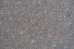 Surface of unpolished grayish pink granite stone. Surface of unpolished greyish pink granite stone Royalty Free Stock Photo