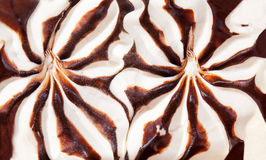 Surface of vanilla ice cream with chocolate sauce Stock Image