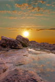 Surface water and rocks. Natural sunset at the seaside. Surface water and rocks Stock Image