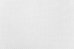Surface of a white synthetic napkin with a large pattern. Background image, texture royalty free stock photo
