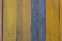 Surface from wooden boards of dark blue and yellow colours Stock Images