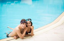 On the surface. Young couple on the surface of the water in the swimming pool Stock Photos