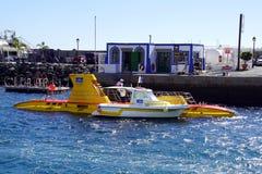 Surfaced Yellow tourist Submarine. stock image