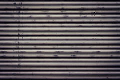 Surfaces gleam in the old garage door. Royalty Free Stock Image