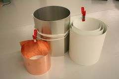 Surfaces for wet application of photographic chemicals. Rolls of Metal sheets of tin copper and steel for wet application of photographic chemicals. brushes used Royalty Free Stock Photos