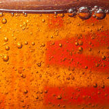 Surfacing. A macro shot of bubbles within a bottle of detergent royalty free stock photography
