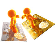 Surfar em um cartão de crédito Fotos de Stock Royalty Free