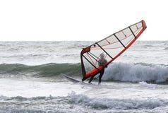 Surfare på en blåsig stormig dag arkivbilder