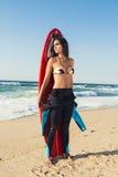 Surfareflicka med hennes surfingbräda Royaltyfria Bilder