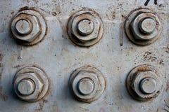Surfase del metal con los tornillos Fotos de archivo
