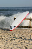 Surfboard. On beach with waves Royalty Free Stock Photo