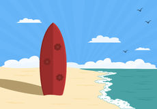 Surfboard. Red surfboard standing upright on sandy beach Royalty Free Stock Images