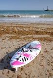 Surfboard on the beach Royalty Free Stock Photos