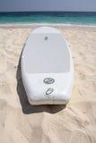 Surfboard on beach Stock Photo