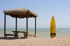 Surfboard and beach hut Royalty Free Stock Images