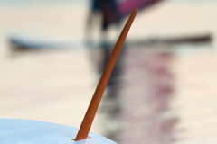 Surfboard fin against a surfer and the ocean. Royalty Free Stock Photos