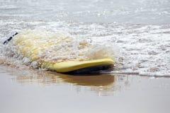 Surfboard floating in the atlantic ocean. In Portugal Stock Photos
