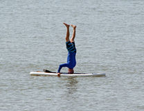 Surfboard headstand Stock Image