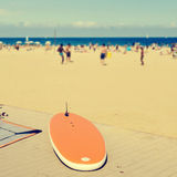 Surfboard at La Barceloneta Beach, in Barcelona, Spain. Closeup of a surfboard at the wooden boardwalk of La Barceloneta Beach, in Barcelona, Spain, with the Royalty Free Stock Photo