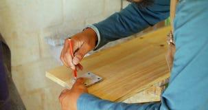 Surfboard maker marking on surfboard 4k. Surfboard maker marking on surfboard in workshop 4k stock video footage