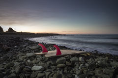 Surfboard. Put aside after morning surf while on holiday. Location Kaikoura, New Zealand a popular surfing destination Stock Images