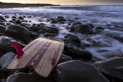 Surfboard. Put aside after morning surf while on holiday. Location Kaikoura, New Zealand a popular surfing destination Stock Photo