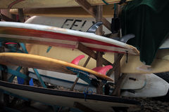 Surfboard Rack. A wooden rack holds a stack of surfboards Stock Photo