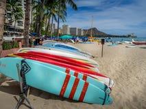 Surfboard rentals, Waikiki. WAIKIKI, HI - APRIL 29 - Surfboard rentals waiting for tourists on Waikiki beach on April 29, 2014 in Oahu. Waikiki beach is Royalty Free Stock Photo