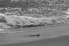Surfboard on the sand Stock Photo