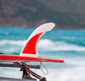 Surfboard by the sea Stock Photography