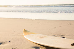 Surfboard on shore at beach Stock Image