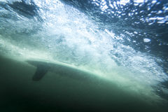 Surfboard underwater with fin and air bubbles Stock Photography