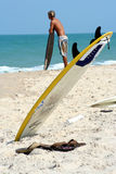 Surfboard Waiting. A surfboard stuck in the beach sand waits for it's owner to take it for a ride Stock Photos