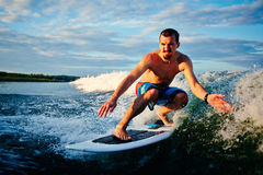 Surfboarder in the sea Stock Photo