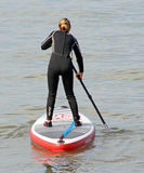 Surfboarding paddle woman Royalty Free Stock Image