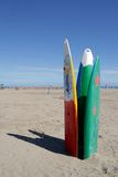 Surfboards on the beach. Three surfboards standing vertically on the beach Royalty Free Stock Photos