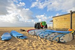 Surfboards and cloting at the beach Royalty Free Stock Photo
