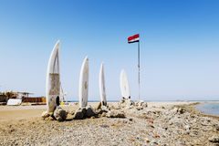 Surfboards and flag of Egypt at the Red Sea Beach Royalty Free Stock Photography