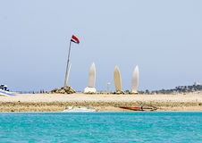 Surfboards and flag of Egypt at the Red Sea Beach. In sunny day Royalty Free Stock Photos